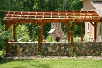 Pergola of Natural Wood and a Stone Wall