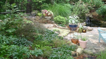 Stone patio and walls with lush plantings