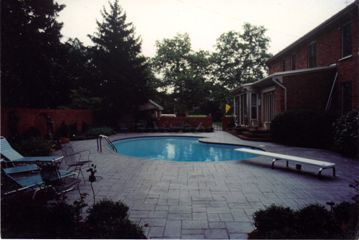 Pool with brick walls and wall fountain