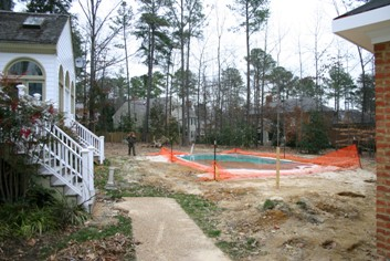 Fiberglass Swimming Pool with a Brick Deck Before
