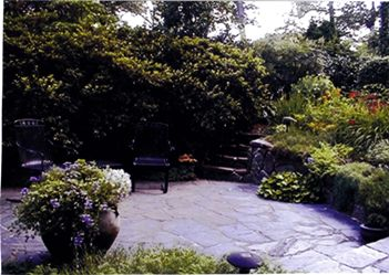 Buckingham Slate Patio with Stone Wall