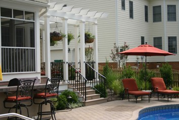Pergola over a deck by a pool