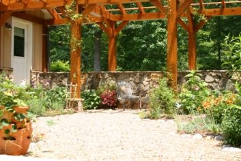 cottage garden with pergola and stone wall