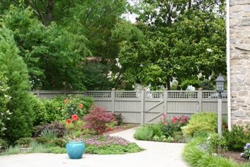 A creative planting design of trees, shrubs, groundcovers and perennials