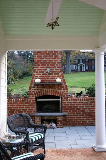 Brick Outdoor Fireplace Build into a Retaining Wall