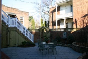 Urban Garden with brick walls and Navastone Pavers
