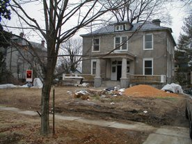Stucco house under construction before landscaping