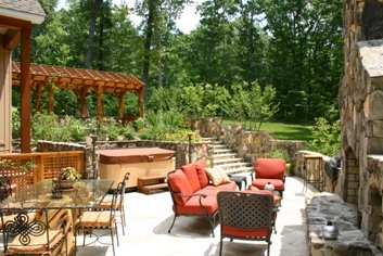 Outdoor room with stone fireplace